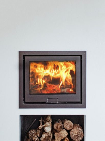 The wood burner at Bowji, a self-catering holiday property in Daymer Bay, North Cornwall