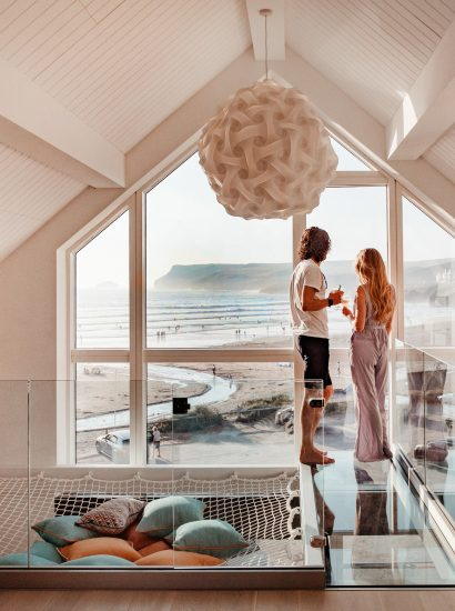 Couple enjoying the view from Chyanna, a luxury, self-catering holiday home in Polzeath, North Cornwall