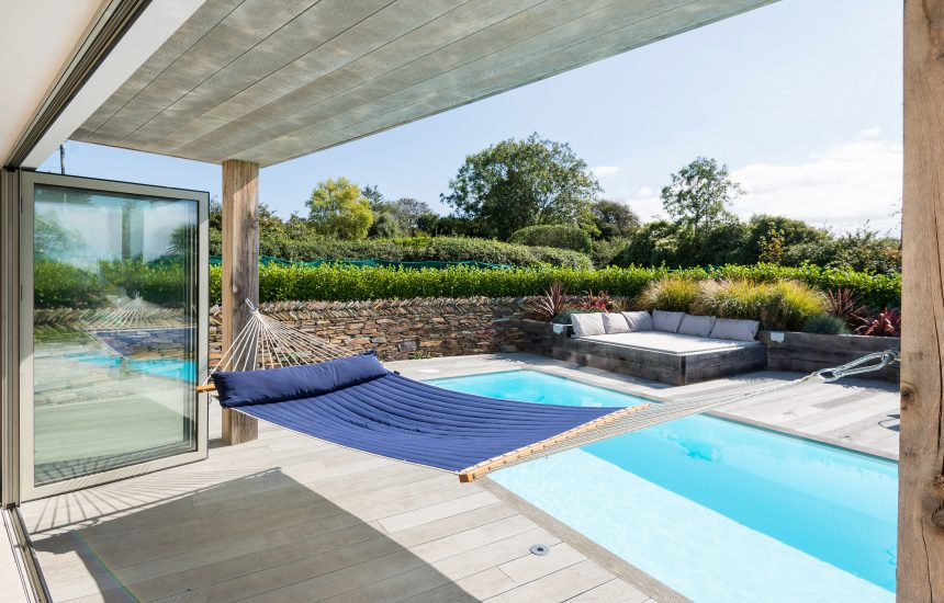 Heated outdoor swimming pool at Fiddlesticks a self-catering holiday property in Rock, North Cornwall