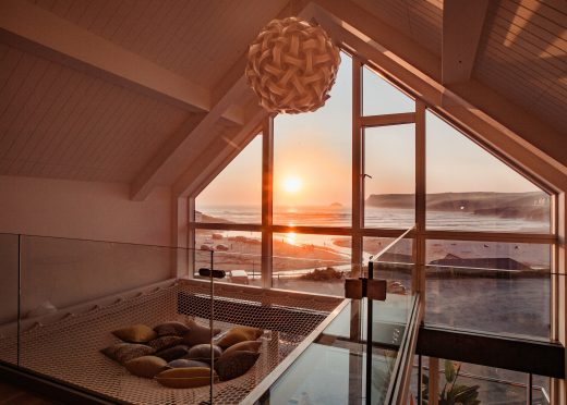 View of the sunset from Gwel Trelsa, a luxury, self-catering holiday home in Polzeath, North Cornwall