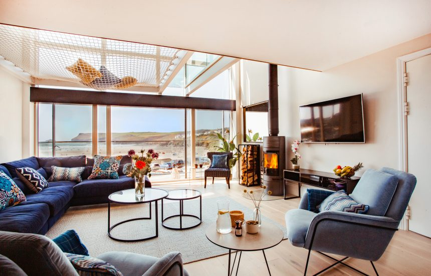 One of the living rooms at Gwel Trelsa, a luxury, self-catering holiday home in Polzeath, North Cornwall