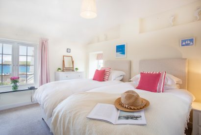 Twin bedroom at Ivy Cottage, a self-catering holiday home in Polzeath, North Cornwall