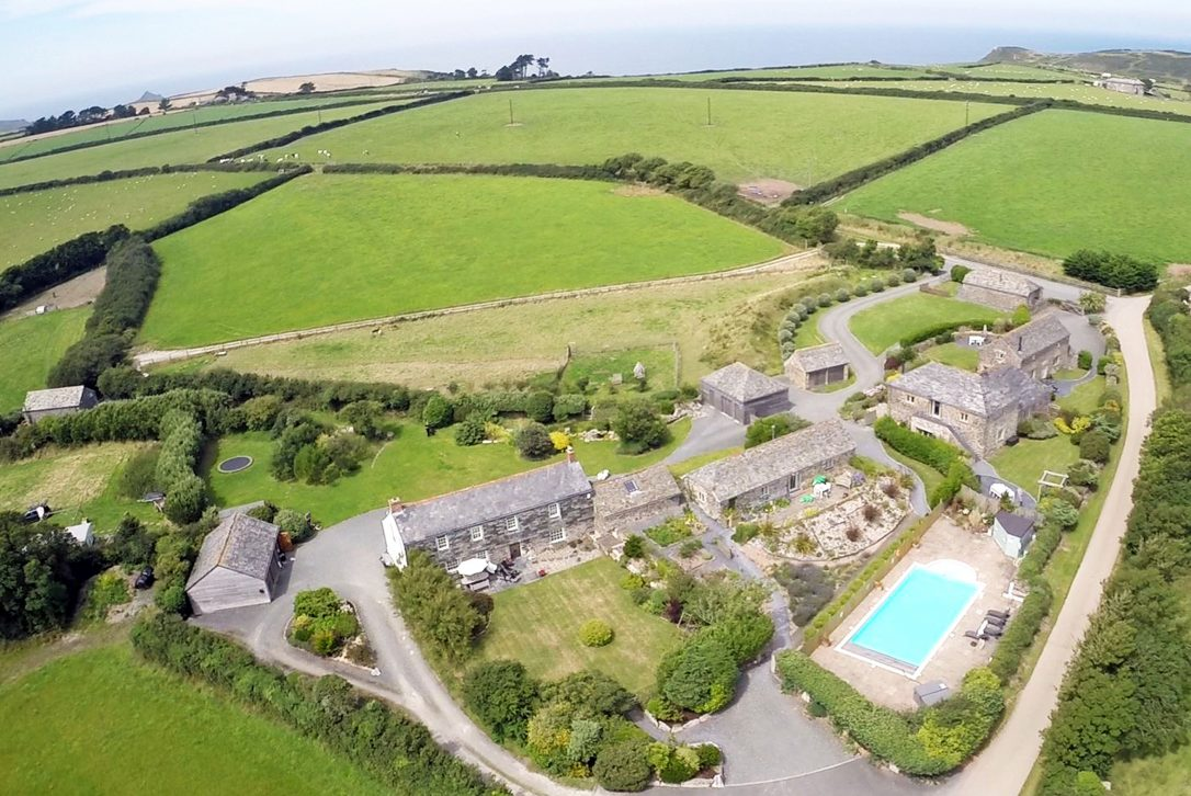Aerial view of Mesmear Farmhouse, a self-catering holiday home in Polzeath, North Cornwall
