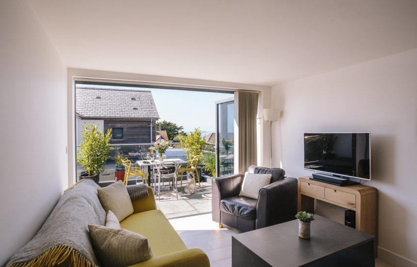 Living space at No 6 Tregales, a self-catering holiday apartment in New Polzeath, North Cornwall