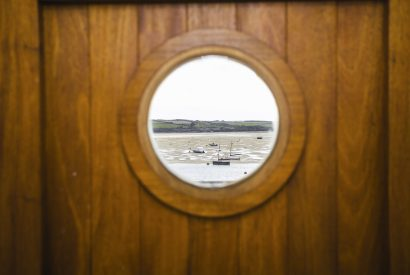 The porthole in the front door at Orchard House, a self-catering holiday cottage in Rock, North Cornwall
