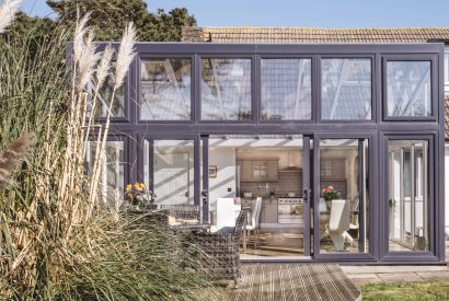 The conservatory at Pinetree Lodge, a self-catering holiday home in Polzeath, North Cornwall