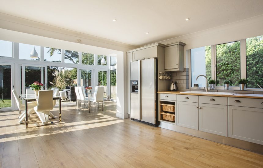 The open plan kitchen and dining area at Pinetree Lodge, a self-catering holiday home in New Polzeath, North Cornwall