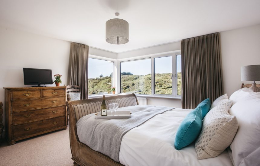 The master bedroom at Seahouse, a self-catering holiday property in Polzeath, North Cornwall