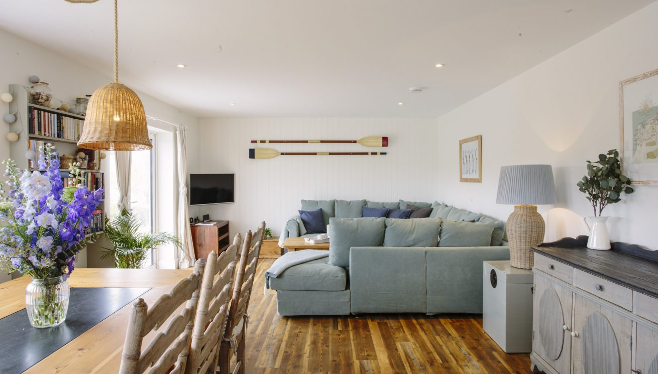 Living and dining area at Seahouse, a self-catering holiday home in Polzeath, North Cornwall