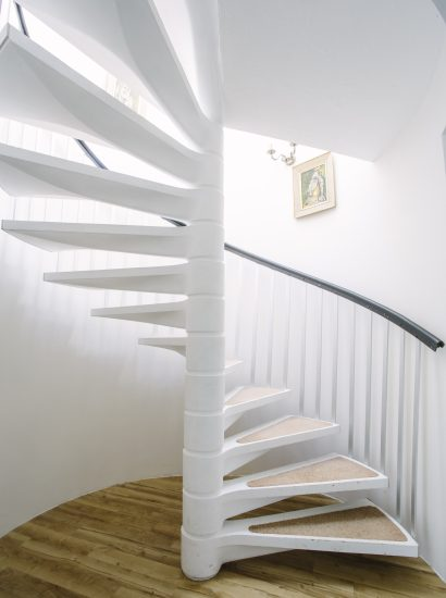 Spiral staircase at Thr Crispin, a self-catering holiday home in Rock, North Cornwall