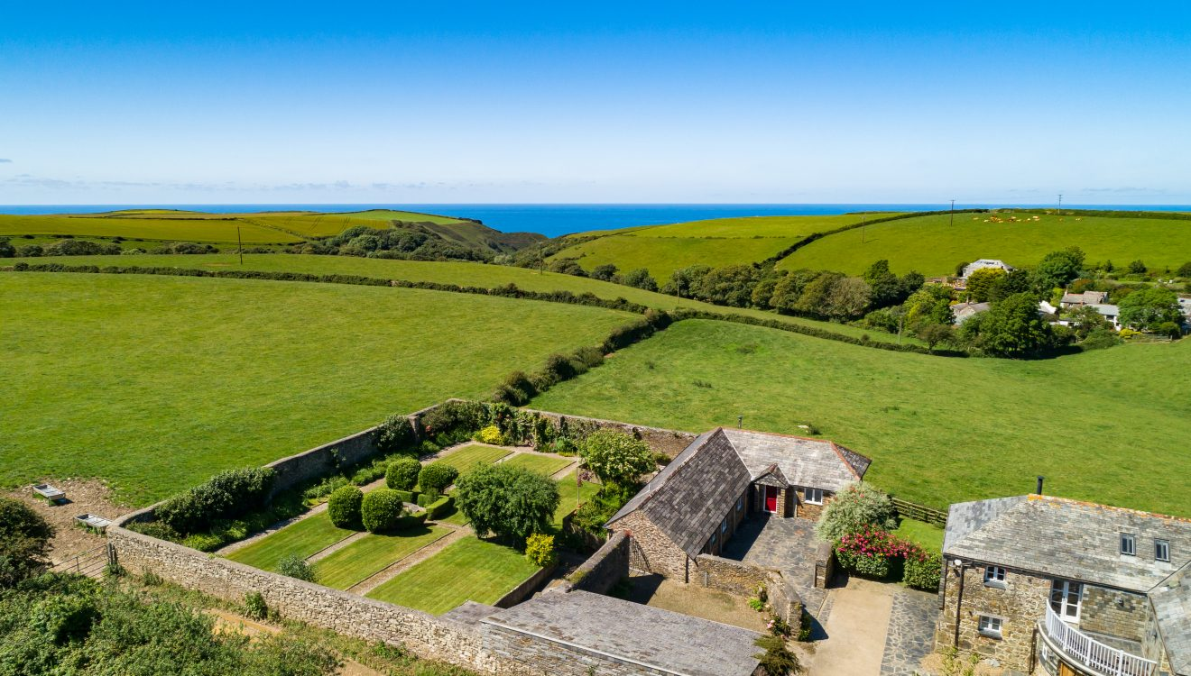 Aerial view of The Linhaye, a self-catering holiday cottage in Port Isaac, North Cornwall