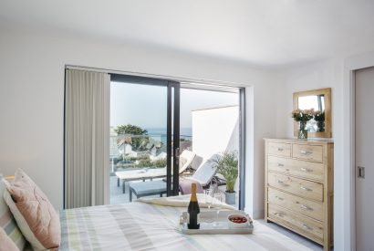 Master bedroom at The Penthouse, a luxury apartment in New Polzeath, North Cornwall