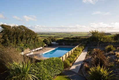 Swimming pool at The Tractor Shed, a self-catering holiday home in Polzeath, North Cornwall