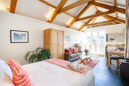Living space at The Tractor Shed, a self-catering holiday home in Polzeath, North Cornwall