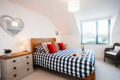 Bedroom one at Amrose, a self-catering holiday home in New Polzeath, North Cornwall