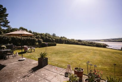 Garden and estuary view at Kate Cottage, a self-catering holiday home near Rock, North Cornwall
