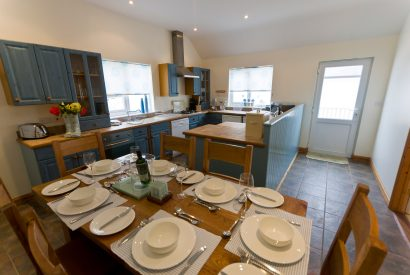 Open plan kitchen and dining room at Cribba, a self-catering holiday home in Port Isaac. North Cornwall