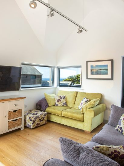 Open plan living and dining room at Endymion, a self-catering holiday home in New Polzeath, North Cornwall
