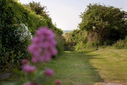 Pathway down to the beach at Little Lynam, a self-catering holiday home in Rock, North Cornwall