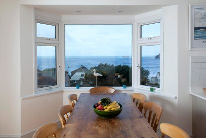 Dining room view at Penroy, a self-catering holiday house in Polzeath, North Cornwall