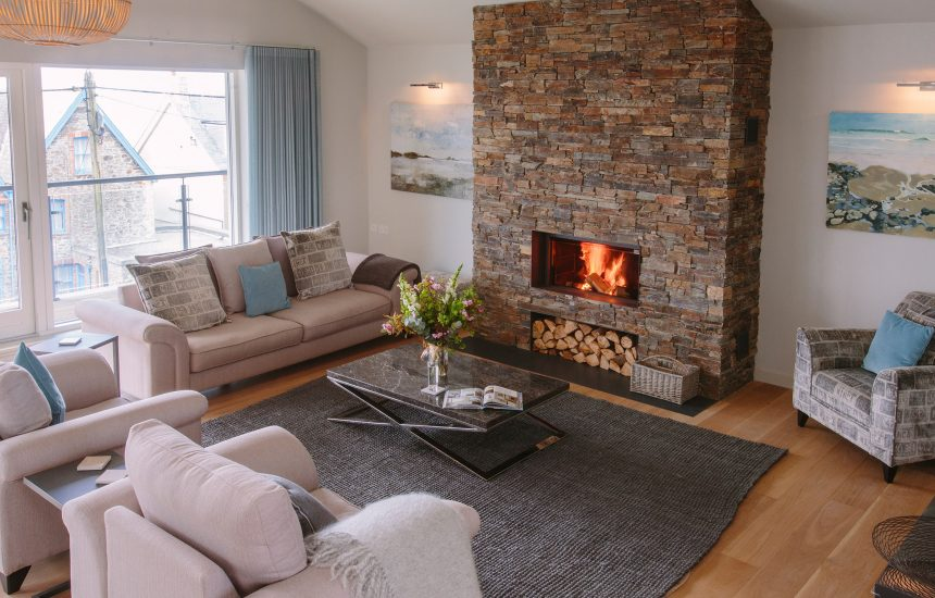 Living room with fire at Rosemar, a self-catering holiday home in New Polzeath, North Cornwall