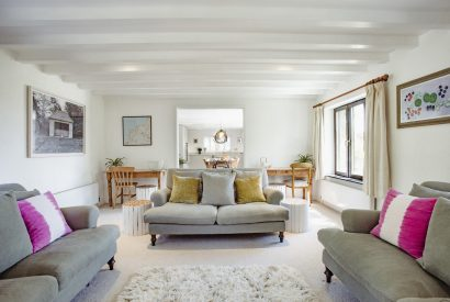 Living room at The Farmhouse, a self-catering holiday home on Cant Farm near Rock, North Cornwall