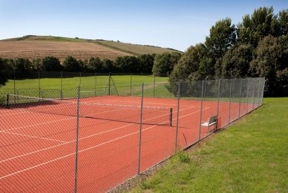 Tennis courts at Cant Farm, a private estate on the banks of the Camel Estuary