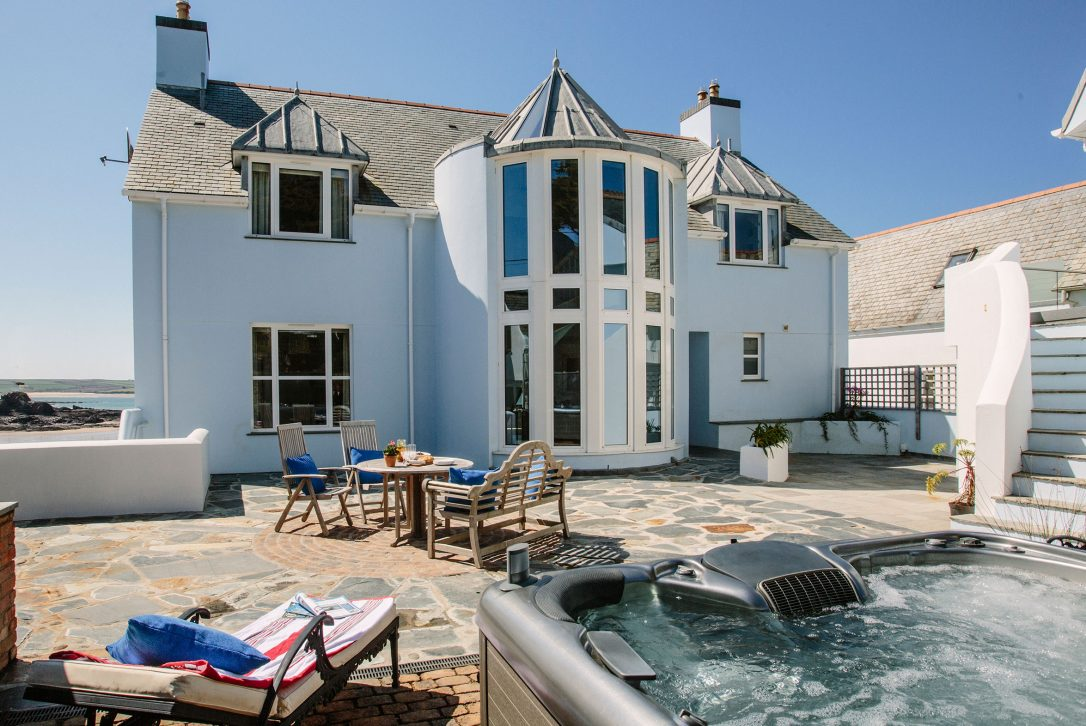 Courtyard with hot tub at Tristram, a self-catering holiday cottage in New Polzeath, North Cornwall