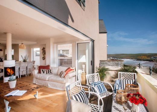 Living space and balcony at Vinnick Rock, a self-catering holiday home in Polzeath, North Cornwall